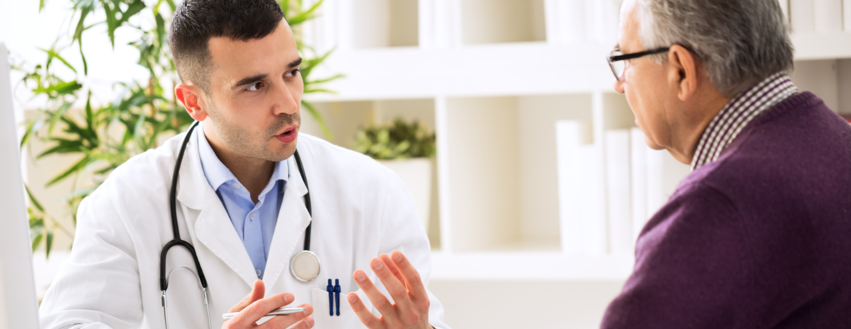 Doctor Consults with Senior Patient