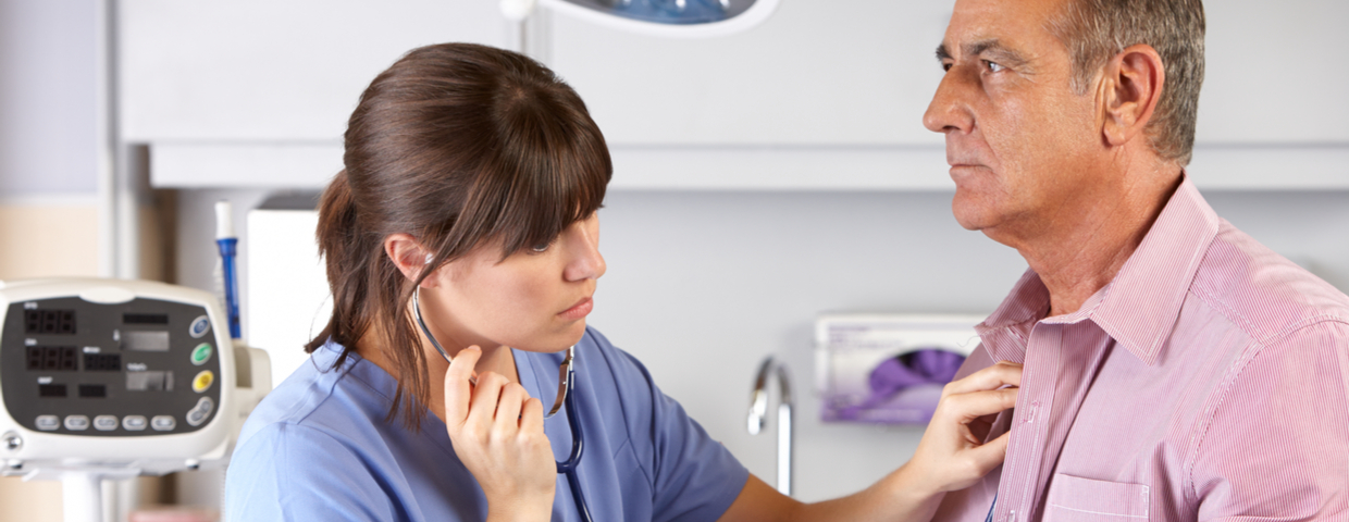 Nurse Checks Patient's Chest with Stethoscope